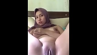 Hijab girl pleasing herself