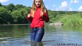 Wet girl in red boots and jeans