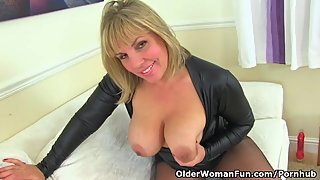 English milf Danielle looks close to perfection in a black dress